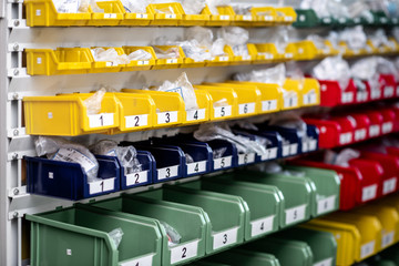 Colorful plastic cells in the warehouse with car parts