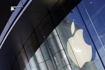 Surveillance camera is seen outside an Apple store in Beijing