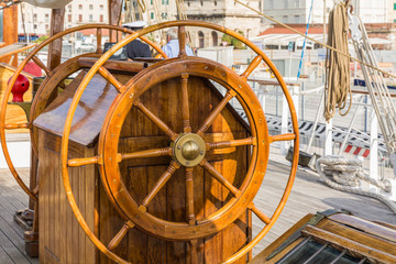 Detail view of the rudder of an old sailing ship in the port of Livorno, Tuscany, Italy