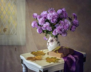 Still life with beautiful bouquet of purple chrysanthemums