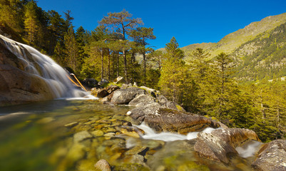Mountain river with waterfall and stones on the bed, Pyrenees Occidentales, France
