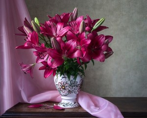 Still life with beautiful bouquet of magenta lily
