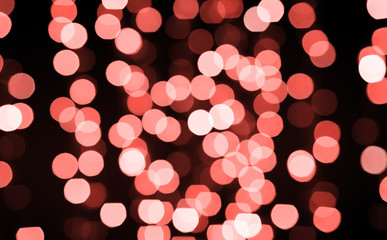 Fotobehang - holidays and design concept - blurred bokeh lights in living coral, color of the year 2019
