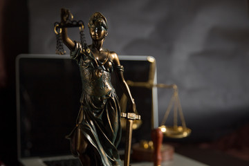 Lady Justice isolated on black background