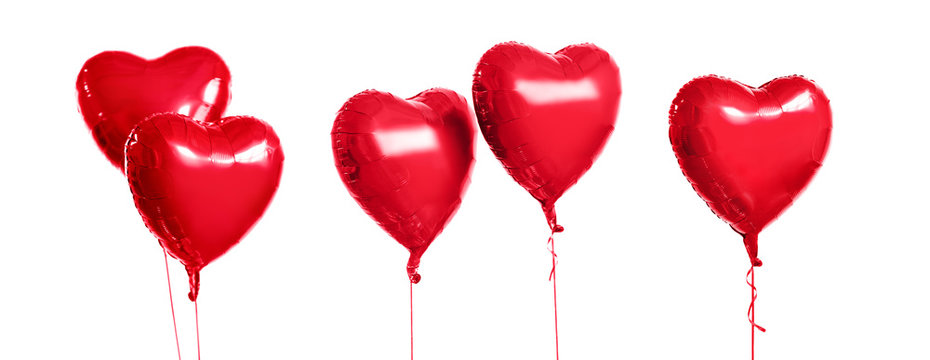 holidays, valentines day and party decoration concept - five metallic foil red helium heart shaped balloons over white background