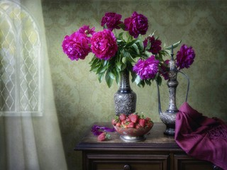Still life with beautiful bouquet of magenta peonies