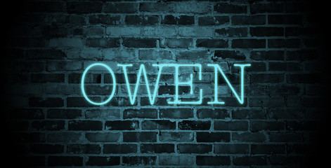 first name Owen in blue neon on brick wall