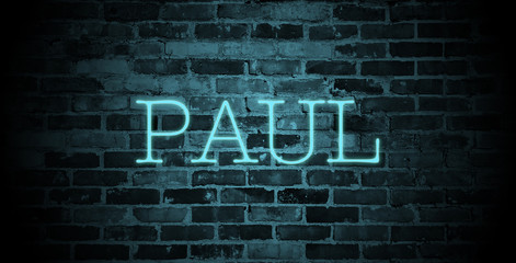 first name Paul in blue neon on brick wall