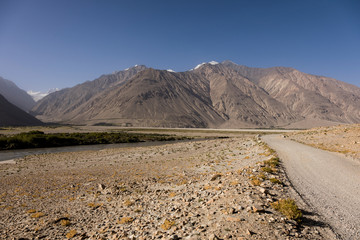 Wahkan valley in Tajikistan. On the left bank of the river is Afghanistan with the Hindu kush