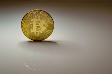 bitcoin coin on gray background
