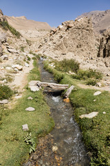 Side valley with creek near Vrang with Pamir Mountains in Tajikistan