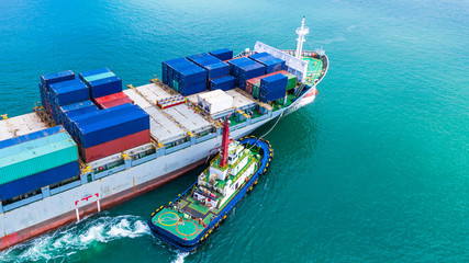 Aerial view container ship carrying container for import and export, business logistic and transportation by ship in open sea.