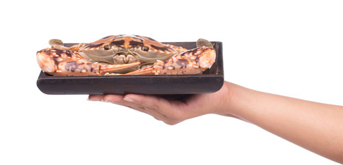hand holding cooked crab prepared on tray weave isolated on white background