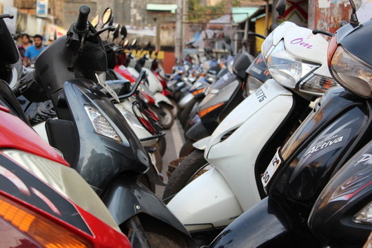 Mopeds Parked in a line