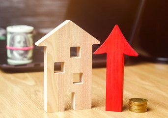 The concept of real estate market growth. The increase in housing prices. Rising prices for utilities. Increased interest in mortgage and rising interest rates on mortgages. focus on the coins