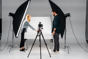 young photographers working with professional equipment in photo studio