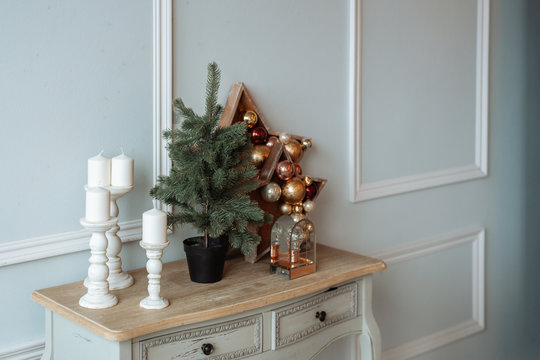 Elements of Christmas decor. A small tabletop tree and Christmas decorations.