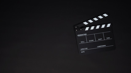 Black Clapperboard or clap board or movie slate use in video production ,film, cinema industry on black background. Wall mural
