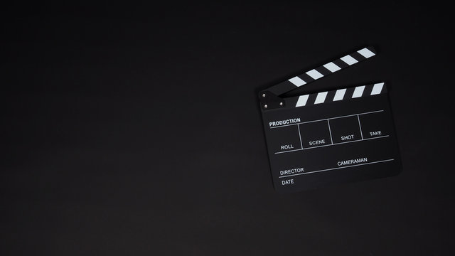 Black Clapperboard or clap board or movie slate use in video production ,film, cinema industry on black background.