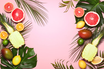 Tropical summer background with various tropical fruits