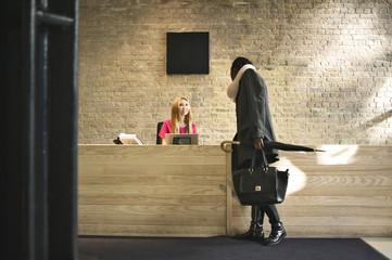 Asian woman at a company reception area
