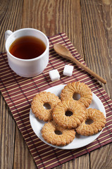 Shortbread cookies and tea on table