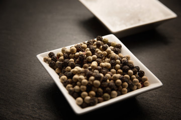 black peppercorns in a bowl
