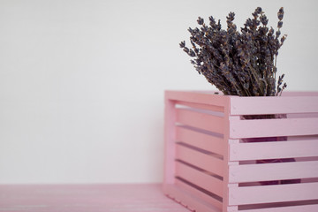 Bouquet of lavender in a pink drawer on a white background