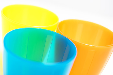 colorful plastic cups on white background