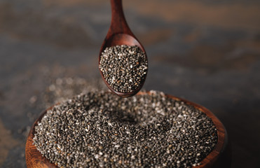 selective focus of wooden spoon and chia seeds in bowl