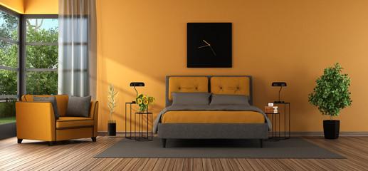 Gray and orange master bedroom