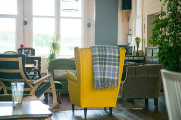yellow chair and black rocking chair