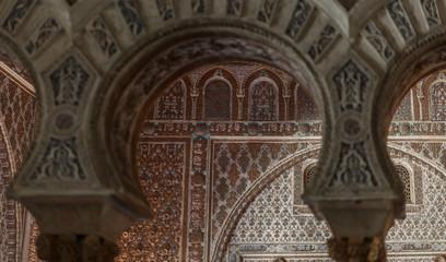Sevilla Alcazar Ambassadors room with horse shoe arches typical moorish plaster work in Mudejar