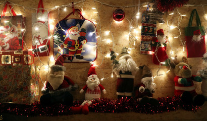 """Christmas decorations are seen in the garden that belongs to Serge Hennebel, nicknamed """"Elf Serge"""", which has been transformed into a Christmas village and adorned with hundreds of lights, in Mille"""