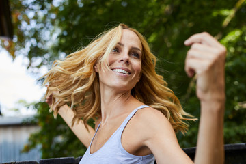 Carefree blond woman outdoors