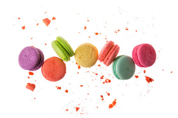 Foto auf Leinwand Macarons Flat lay. Close up. Sweet french macarons isolated on white background. Colorful macaroons flying or falling in motion.