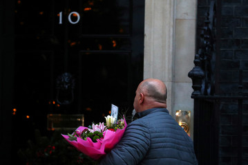 A man delivers a bouquet of flowers for Britain's Prime Minister Theresa May in Downing Street, London