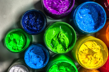 photography top view of colorful ink for print tee shirt.factory. Plastisol ink useful in tee shirt factory and in industry .