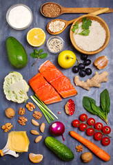 Healthy food clean eating selection: salmon fish, fruits, vegetables, cereals. View from above, top studio shot