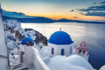 Wall Mural - Beautiful view of Santorini island in Greece at sunrise with dramatic sky.