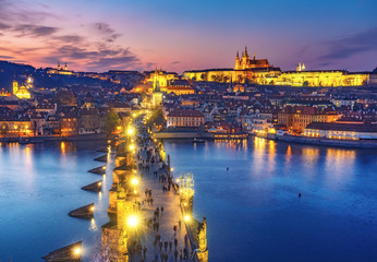 Scenic aerial view on Charles bridge and Prague castle in Prague, Czech Republic, at sunset. Beautiful travel background.