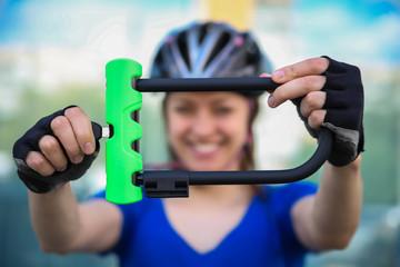 Girl with bicycle  lock. Bicycle U- lock