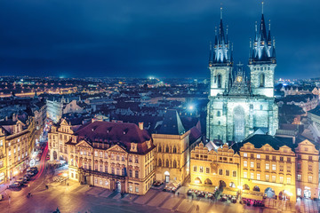 Aerial view on Old town with Tyn church in Prague, Czech republic, at night. Colourful skyline.