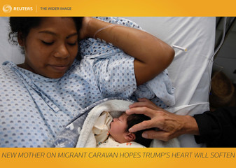 The Wider Image: New mother on migrant caravan hopes Trump's heart softens