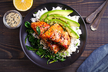 Salmon in honey-soy glaze with rice, spinach and avocado. overhead, horizontal