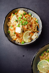 Vegetarian fried rice with tofu, peas and vegetables. Asian cuisine, healthy lunch