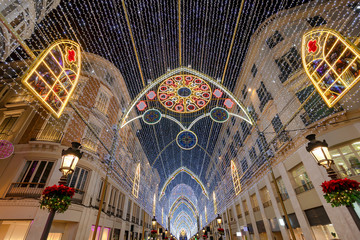 Christmas decorations on Calle Marques de Larios street in the centre of Malaga city, Andalusia, Spain. Most popular pedestrian street of Malaga