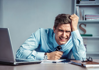 Crying man. Photo of office man with Negative facial expression at the working place, depression and crisis concept