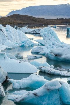 Eisbergs in glacier lagoon Jokulsarlon before sunset, Iceland