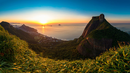 Fototapete - Scenic Panoramic View of Sunrise in Rio de Janeiro City, Pedra da Gavea, Sao Conrado Beach, and Two Brothers Mountain With Favela Rocinha